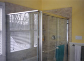 Frameless sliding doors with silicone butt joint and return panel
