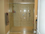 Handicap frameless shower set without a tile treshold – Door extra wide to allow access with wheelchair – Panel set with channel top & bottom