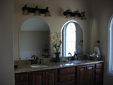 Beveled arched mirrors
