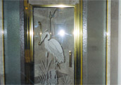 Sandblasted crane on clear framed door – Unit has obscure panels